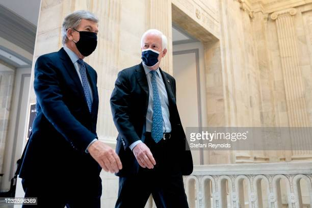 Senator Roy Blunt and Senator John Cornyn wear protective masks while arriving to Senate Republican policy luncheon at the Russell Senate Office...
