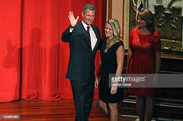 Senator Scott Brown stands with his daughter, Arianna, and his wife, Gail Huff, after participating in a televised debate against democratic...