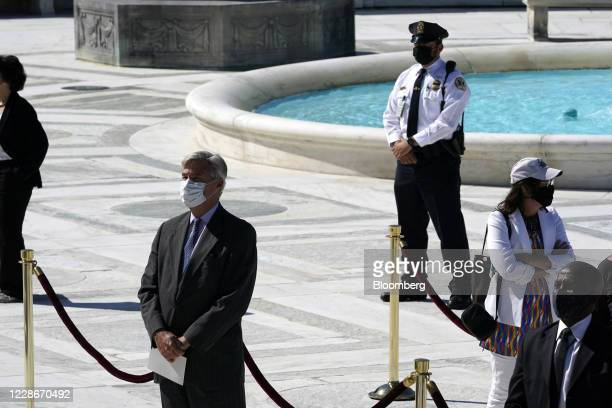 Senator Sheldon Whitehouse, a Democrat from Rhode Island, pay respects to late Supreme Court Justice Ruth Bader Ginsburg outside the Supreme Court in...