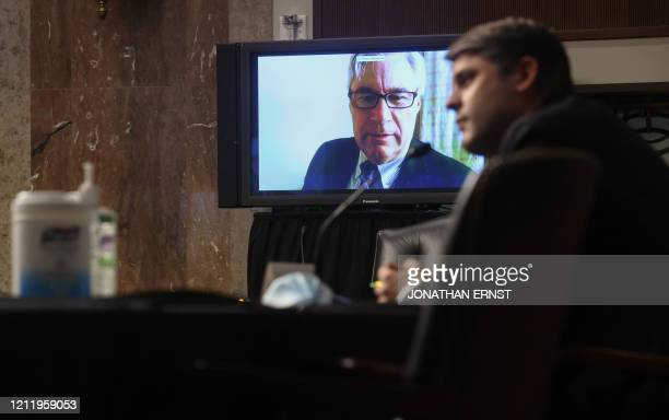 US Senator Sheldon Whitehouse questions Judge Justin Walker remotely by video link because of the outbreak of coronavirus disease during Walker's...