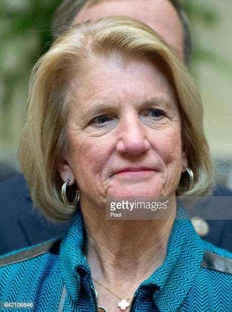S Senator Shelley Moore Capito listens as US President Donald J Trump makes remarks prior to signing HJ Res 38 disapproving the rule submitted by the...