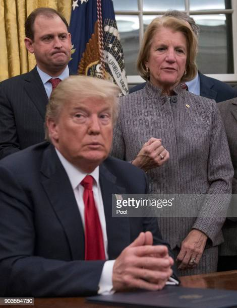 S Senator Shelley Moore Capito makes remarks in the Oval Office prior to President Donald Trump signing the bipartisan Interdict Act a bill to stop...