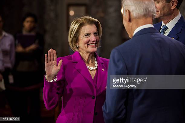 Senator Shelley Moore Capito reenacts her swearing in to the 114th US Congress with Vice President Joe Biden in Washington DC on January 6 2015