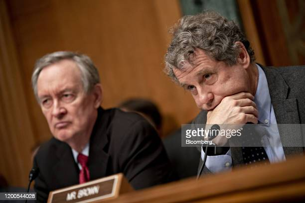 Senator Sherrod Brown a Democrat from Ohio and ranking member of the Senate Banking Committee right and chairman Senator Mike Crapo a Republican from...