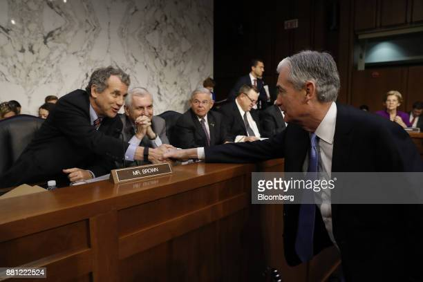 Senator Sherrod Brown a Democrat from Ohio left shakes hands with Jerome Powell chairman of the US Federal Reserve nominee for US President Donald...