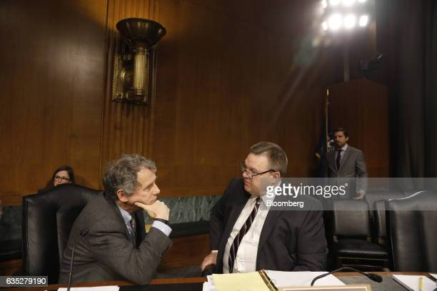 Senator Sherrod Brown left a Democrat from Ohio speaks with Senator Jon Tester a Democrat from Montana before Janet Yellen chair of the US Federal...