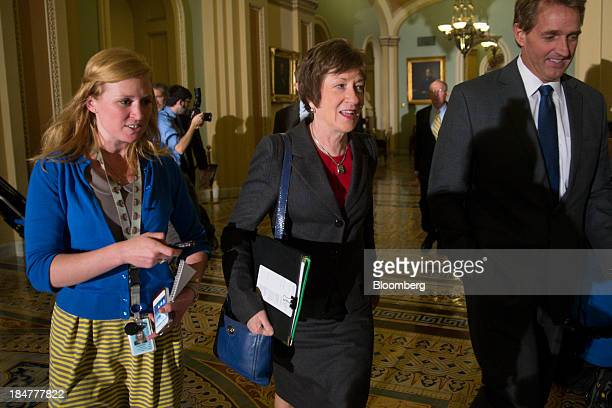 Senator Susan Collins a Republican from Maine center and Senator Jeff Flake a Republican from Arizona right walk to a Republican caucus meeting at...