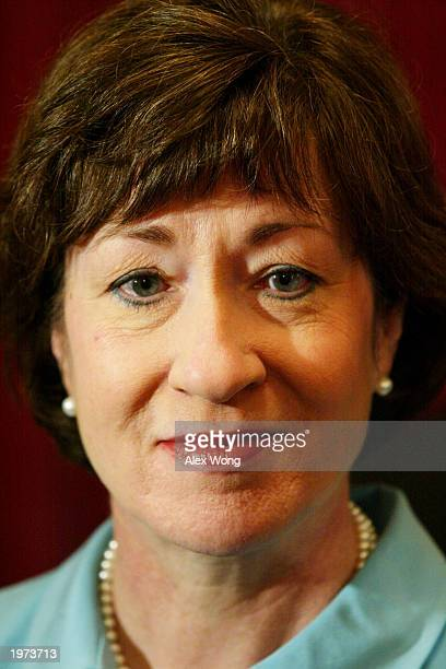 Senator Susan Collins listens to questions from reporters after attending a media conference releasing McCarthy era records May 5, 2003 on Capitol...
