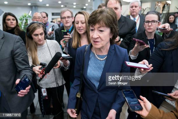 Senator Susan Collins walks to the Senate subway following a vote in the Senate impeachment trial that acquitted President Donald Trump of all...