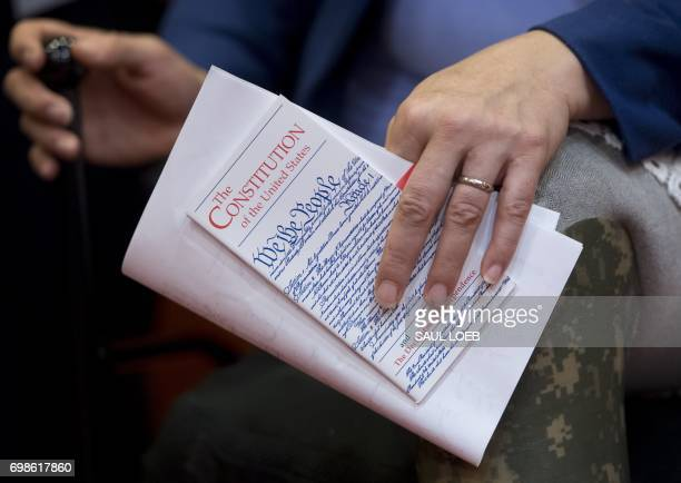 US Senator Tammy Duckworth Democrat of Illinois holds a pocket US Constitution as members of Congress hold a press conference regarding a lawsuit...