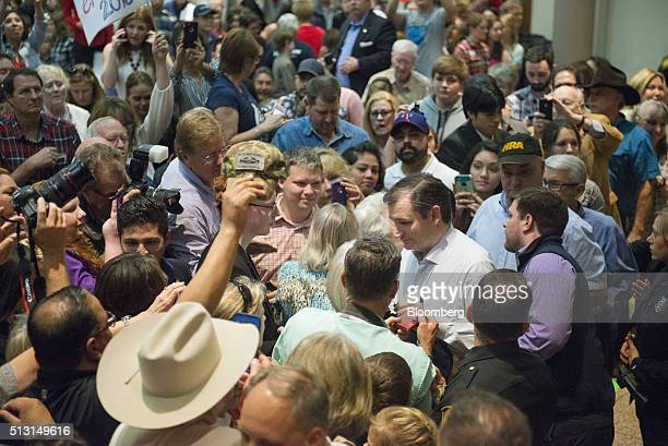 Senator Ted Cruz a Republican from Texas and 2016 presidential candidate greets attendees during a campaign event in San Antonio Texas US on Monday...