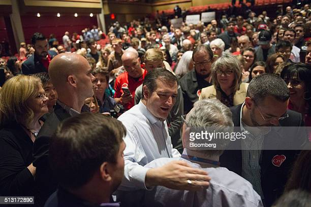 Senator Ted Cruz a Republican from Texas and 2016 presidential candidate center greets attendees during a campaign event in Houston Texas US on...