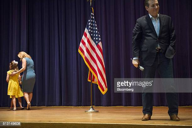 Senator Ted Cruz a Republican from Texas and 2016 presidential candidate smiles while his wife Heidi Cruz and children walk offstage during a...