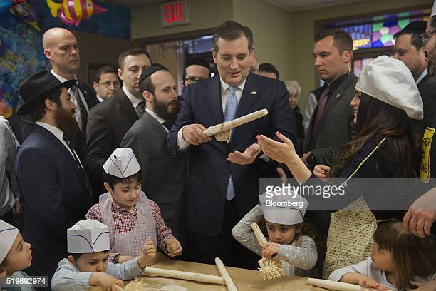 Senator Ted Cruz a Republican from Texas and 2016 presidential candidate center participates in a play matzo bakery with children at the Chabad...