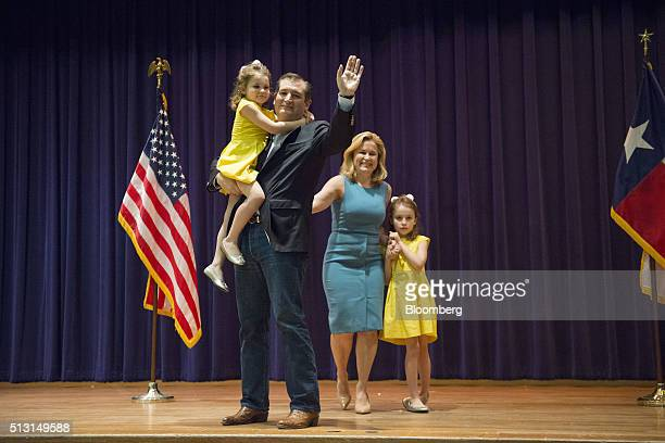 Senator Ted Cruz a Republican from Texas and 2016 presidential candidate greets attendees with his wife Heidi Cruz and children during a campaign...