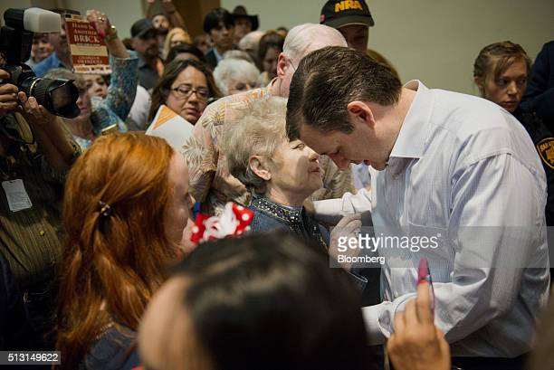 Senator Ted Cruz a Republican from Texas and 2016 presidential candidate prays with an attendee during a campaign event in San Antonio Texas US on...