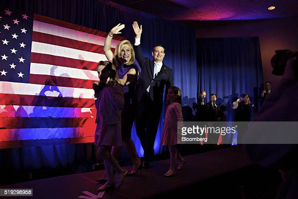 Senator Ted Cruz a Republican from Texas and 2016 presidential candidate right waves with his wife Heidi Cruz as they arrive with their two daughters...