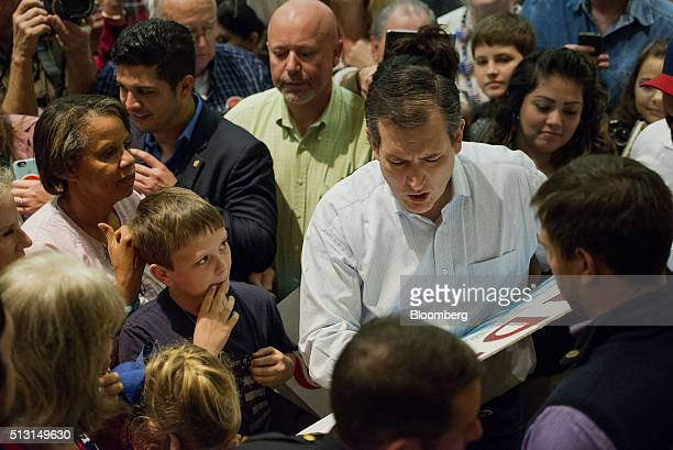 Senator Ted Cruz a Republican from Texas and 2016 presidential candidate signs an autograph for an attendee during a campaign event in San Antonio...