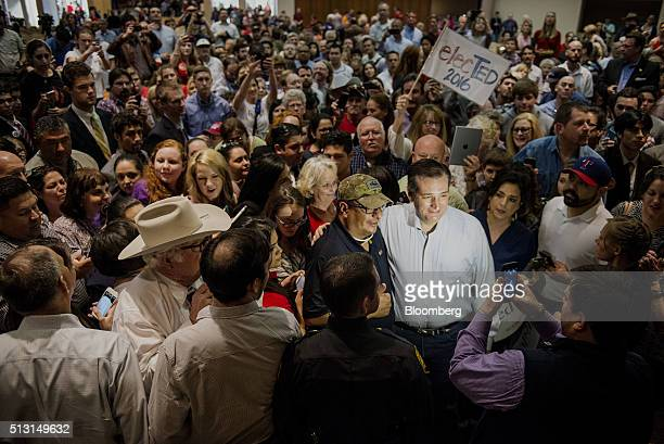 Senator Ted Cruz a Republican from Texas and 2016 presidential candidate stand for a photograph with an attendee during a campaign event in San...
