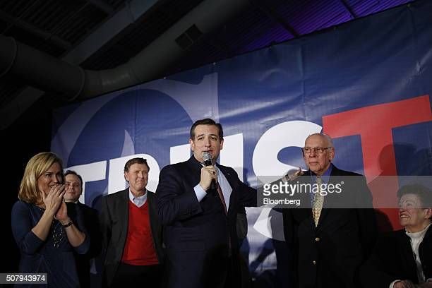 Senator Ted Cruz a Republican from Texas and 2016 presidential candidate center stands next to his father Rafael Cruz second right as his wife Heidi...