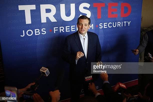Senator Ted Cruz a Republican from Texas and 2016 presidential candidate speaks to the media before a campaign event in Borden Indiana US on Monday...