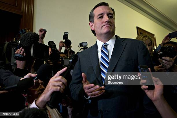 Senator Ted Cruz, a Republican from Texas and former 2016 presidential candidate, speaks to the media as he arrives to his office in the Russell...