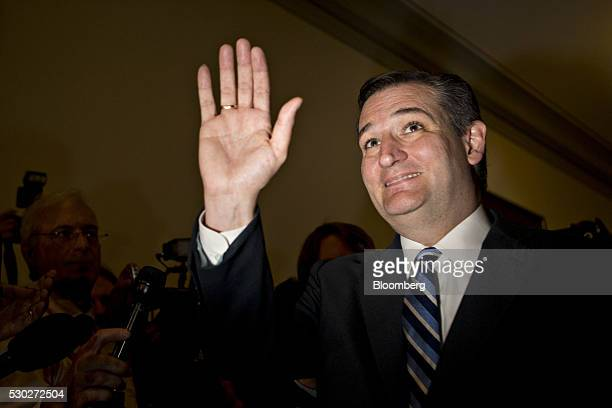 Senator Ted Cruz a Republican from Texas and former 2016 presidential candidate waves after speaking to the media as he arrives to his office in the...