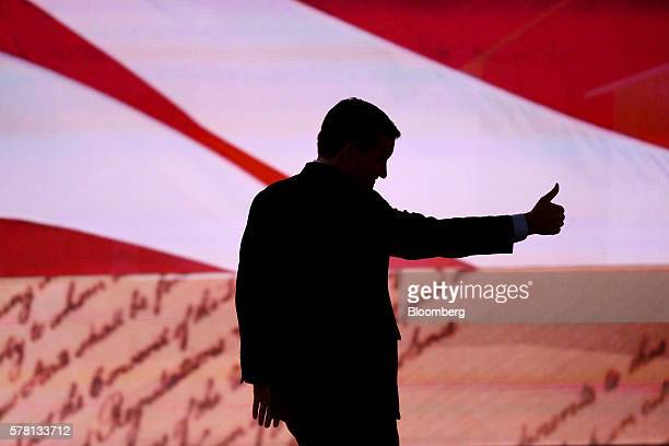 Senator Ted Cruz a Republican from Texas gestures while exiting after speaking during the Republican National Convention in Cleveland Ohio US on...