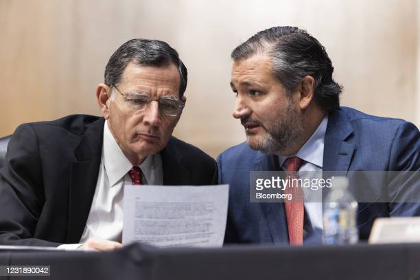 Senator Ted Cruz, a Republican from Texas, right, speaks with Senator John Barrasso, a Republican from Wyoming, during a Senate Foreign Relations...