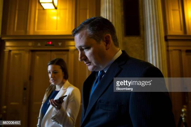 Senator Ted Cruz a Republican from Texas speaks with a member of the media while walking through the US Capitol in Washington DC US on Wednesday Nov...