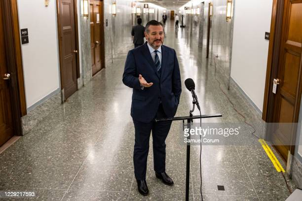 Senator Ted Cruz talks to reporters before heading into a Judiciary Committee hearing where Republicans will vote on whether or not to move the...