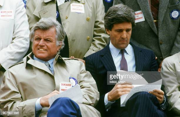 Senator Ted Kennedy and former Lt Governor John Kerry listen as Presidential candidate Michael Dukakis announces he is running for president in...