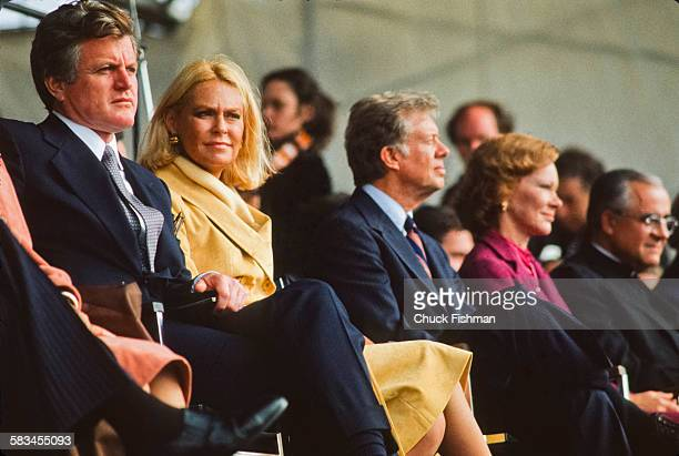 Senator Ted Kennedy left sits with his wife Joan next to President Jimmy Carter center and his wife Rosalynn at the memorial dedication ceremony for...