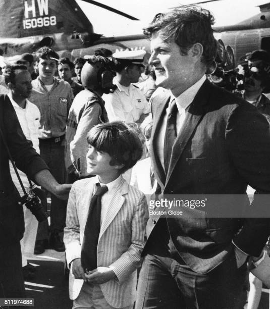 Senator Ted Kennedy watches the aircraft carrier USS John F Kennedy arrive in the Boston Harbor for the first time Aug 3 1970
