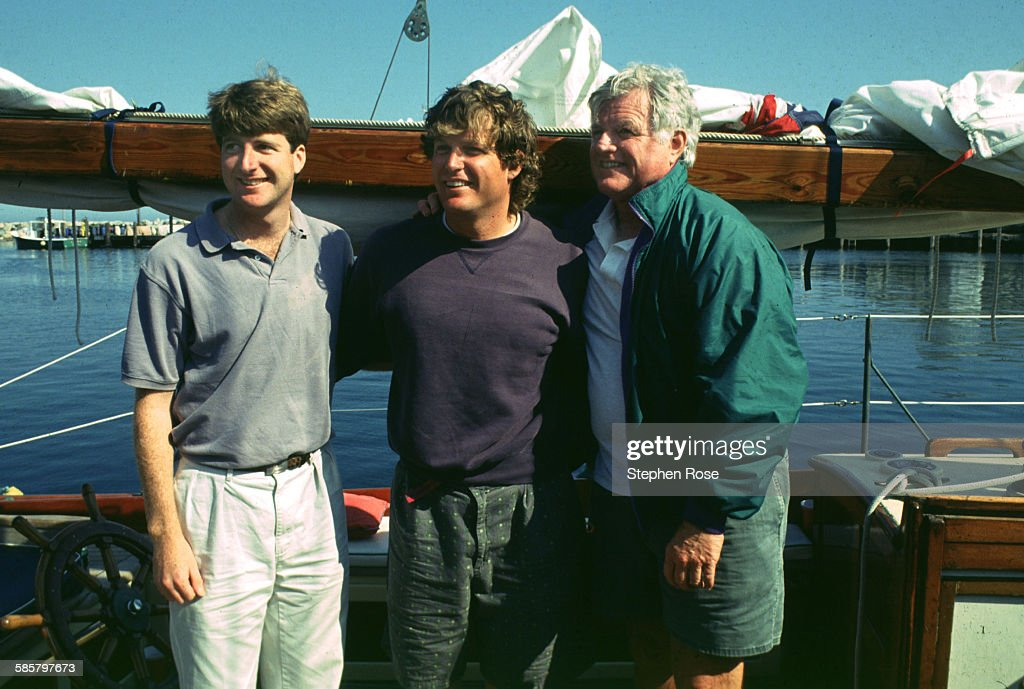 Senator Ted Kennedy with his sons Patrick, left and Edward Jr. on his sailboat 'Mya', USA, 9th October 1993.