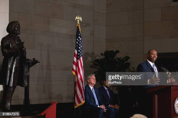 Senator Tim Scott speaks as Majority Leader Kevin McCarthy and Rep Cedric Richmond chairman of the Black Congressional Caucus listen at the...