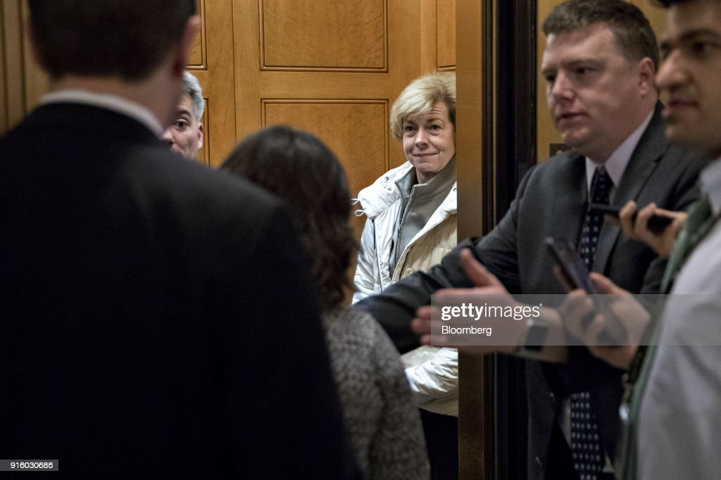 Senator Tina Smith, a Democrat from Minnesota, center right, stands in an elevator after a procedural vote at the U.S. Capitol in Washington, D.C., U.S., on Friday, Feb. 9, 2018. The Senate passed a two-year budget agreement early Friday that would boost federal spending by $300 billion and suspend the debt ceiling for a year, as lawmakers sought to end a partial government shutdown that began at midnight after Congress missed a funding deadline. Photographer: Andrew Harrer/Bloomberg via Getty Images