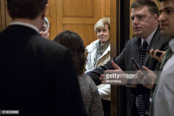Senator Tina Smith a Democrat from Minnesota center right stands in an elevator after a procedural vote at the US Capitol in Washington DC US on...