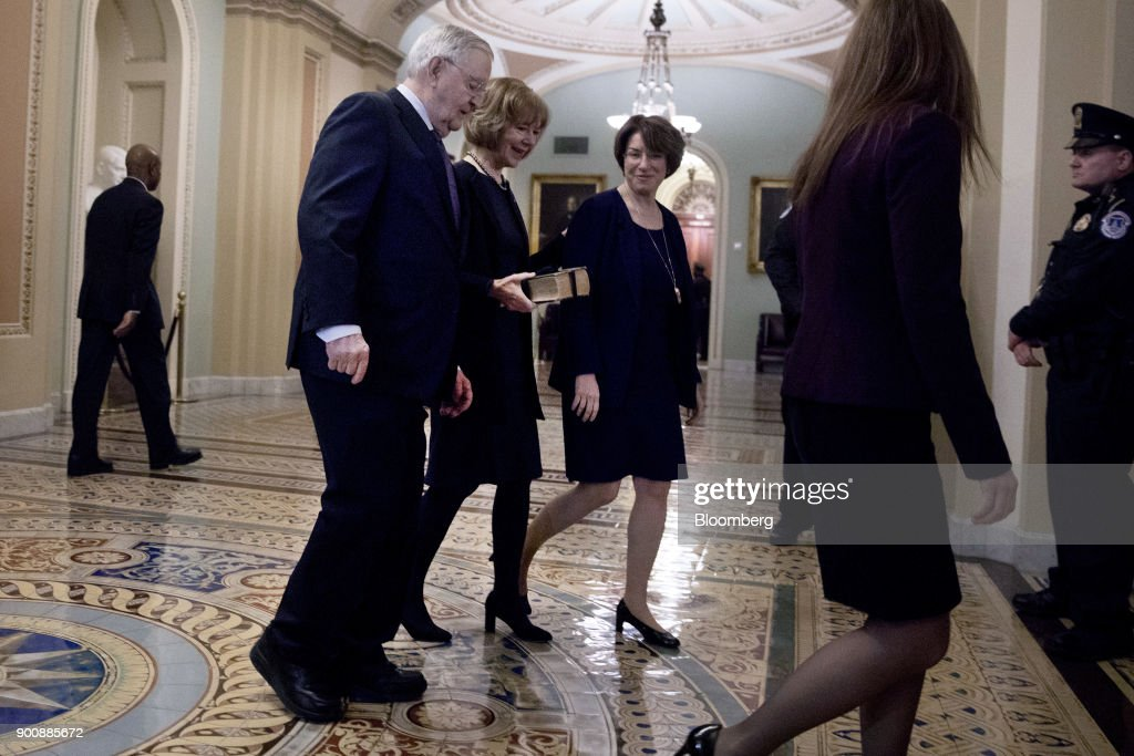 Senator Tina Smith, a Democrat from Minnesota, center, walks to a swearing in ceremony in the Old Senate Chamber of the U.S. Capitol in Washington, D.C, U.S., on Wednesday, Jan. 3, 2018. Smith brought the number of female senators to 22 when she took the seat of former Senator Al Franken, who resigned under pressure from fellow Democrats in December following allegations of sexual misconduct. Photographer: Aaron P. Bernstein/Bloomberg via Getty Images