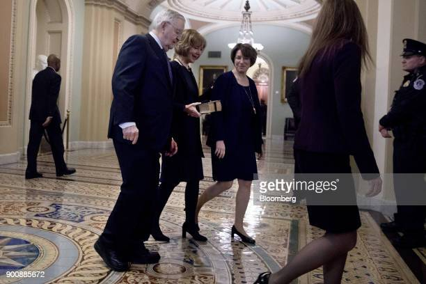 Senator Tina Smith a Democrat from Minnesota center walks to a swearing in ceremony in the Old Senate Chamber of the US Capitol in Washington DC US...