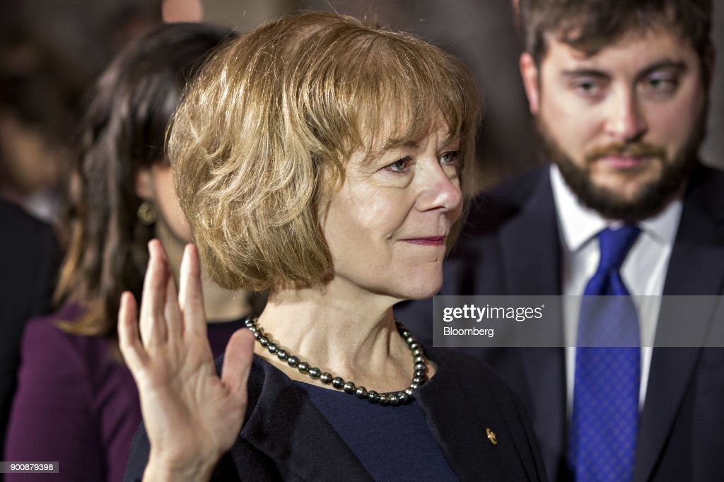 Senator Tina Smith, a Democrat from Minnesota, is sworn-in by U.S. Vice President Mike Pence, not pictured, during a mock swear-in ceremony in the Old Senate Chamber of the U.S. Capitol in Washington, D.C, U.S., on Wednesday, Jan. 3, 2018. Smith was appointed by Minnesota Governor Mark Dayton to the seat vacated by Senator Al Franken who resigned after allegations of sexual harassment. Photographer: Andrew Harrer/Bloomberg via Getty Images