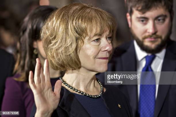 Senator Tina Smith a Democrat from Minnesota is swornin by US Vice President Mike Pence not pictured during a mock swearin ceremony in the Old Senate...