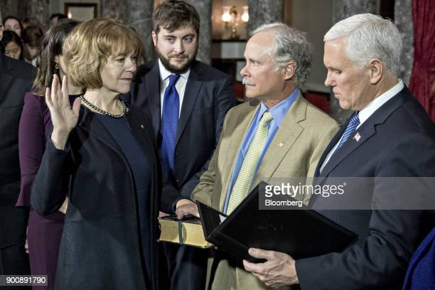 Senator Tina Smith a Democrat from Minnesota left is swornin by US Vice President Mike Pence right during a mock swearin ceremony with husband Archie...