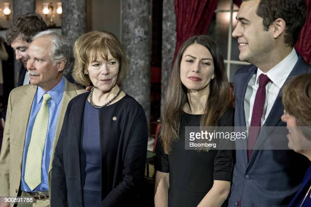 Senator Tina Smith a Democrat from Minnesota second left stands during a photograph with husband Archie Smith left after being swornin by US Vice...