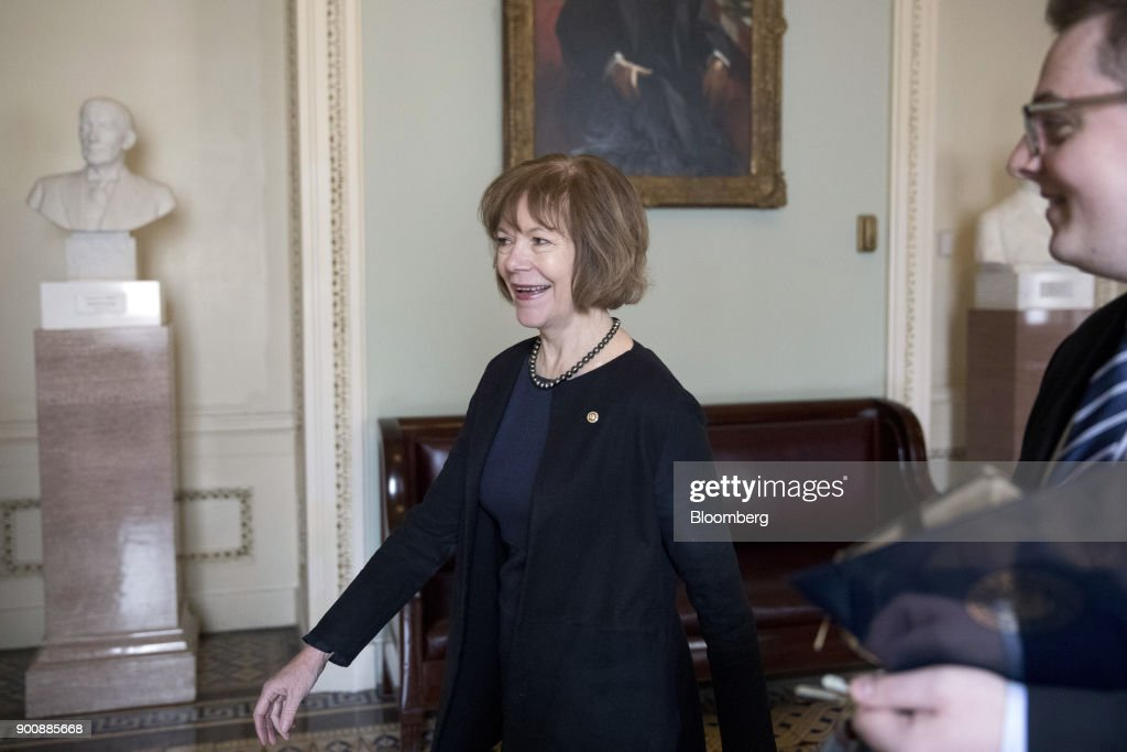 Senator Tina Smith, a Democrat from Minnesota, walks to a swearing in ceremony in the Old Senate Chamber of the U.S. Capitol in Washington, D.C, U.S., on Wednesday, Jan. 3, 2018. Smith brought the number of female senators to 22 when she took the seat of former Senator Al Franken, who resigned under pressure from fellow Democrats in December following allegations of sexual misconduct. Photographer: Aaron P. Bernstein/Bloomberg via Getty Images