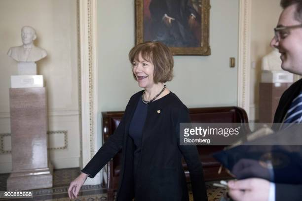 Senator Tina Smith a Democrat from Minnesota walks to a swearing in ceremony in the Old Senate Chamber of the US Capitol in Washington DC US on...