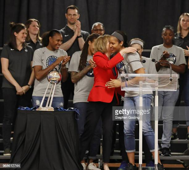 Senator Tina Smith hugs Maya Moore of the Minnesota Lynx during a press conference after the Minnesota Lynx participate in a community event giving...