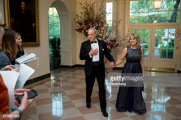 Senator Tom Carper, a Democrat from Delaware, center, and Martha Carper speak to the media as they arrive at a state dinner hosted by U.S. President...