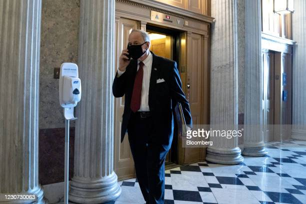Senator Tom Carper, a Democrat from Delaware, wears a protective mask while walking to the Senate Chamber in Washington, D.C., U.S., on Friday, Jan....