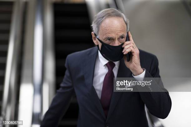 Senator Tom Carper, a Democrat from Delaware, wears a protective mask while walking through the U.S. Capitol in Washington, D.C., U.S., on Tuesday,...